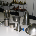 denn spun sample parts, metal spinning, shear forming